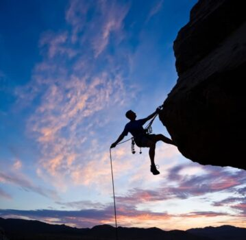 rock climber profile with sunset in background