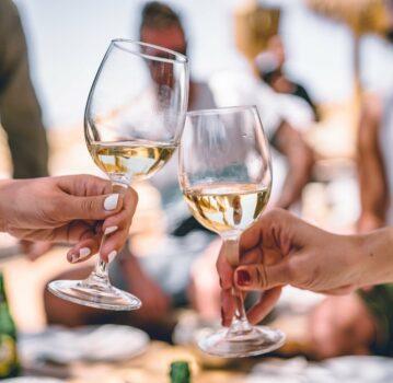white wine glasses cheers outdoors